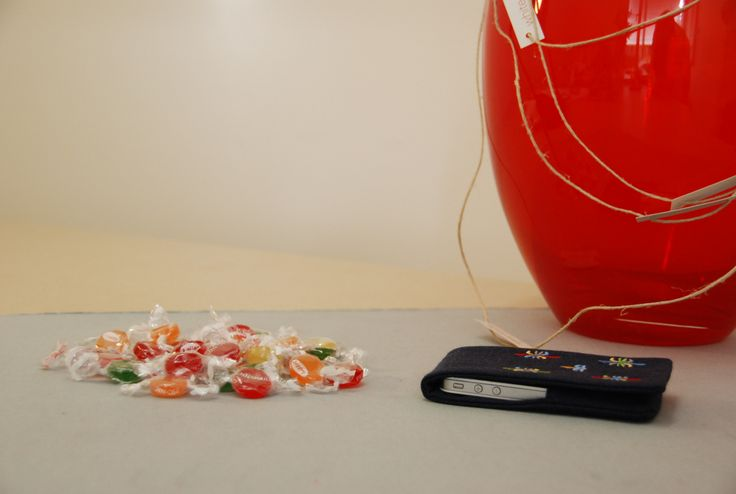 mobile case by 'white tales'. Made from Greek natural cotton fabric, embroidered with motif inspired by Greek tradition