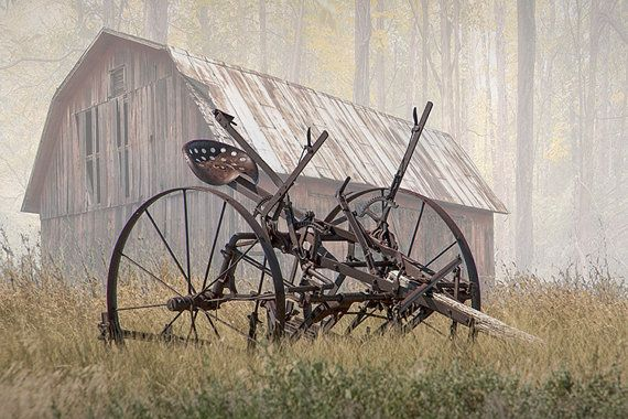 Old Farm Equipment on a foggy morning by a Red by RandyNyhofPhotos
