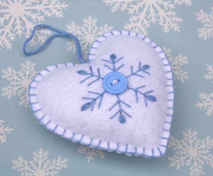 Felt Christmas Ornament, Scandinavian Heart ornament, Felt heart decoration,Embroidered Snowflake heart, Holiday decor, Handmade felt heart by PuffinPatchwork on Etsy https://www.etsy.com/listing/116049286/felt-christmas-ornament-scandinavian