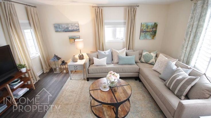 Pastel colours make Jen & Elana's living room airy and inviting -- as seen on Income Property from @hgtvcanada. PARA's Front Façade (P5226-24) is on the walls, and the side tables are painted in Mennonite Grey Tint 2 (P2112-01.)