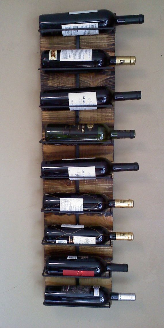 Wall hanging wine Rack for 9. $165.00, via Etsy.