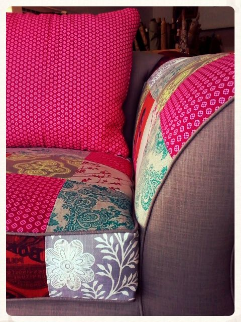 Couch: re-upholstered in clay and bright colourful patches.