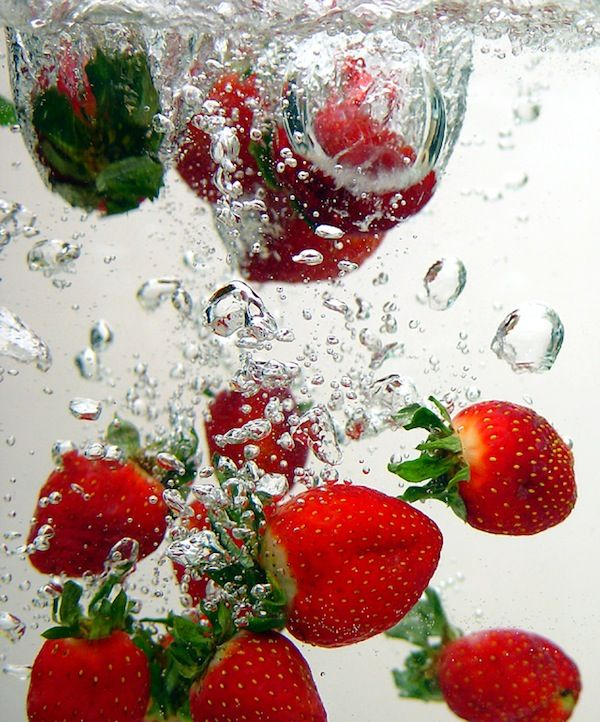 Strawberries dropping into water!