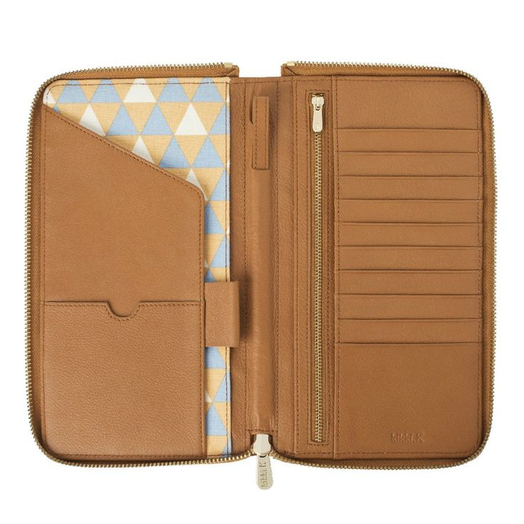 #kikkik Ensure every journey is a breeze with this stylish and functional premium #Leather Travel Wallet. #stockholm #travelwallet #swedishdesign