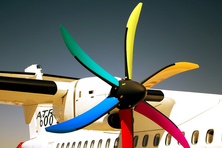 In order to protect the planes propellers they attach these vibrant colorful covers on them when they aren't being used and merely put on display.