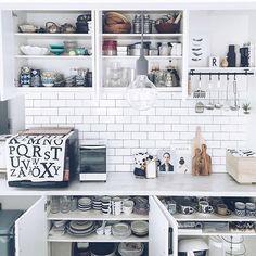 Instagram media by romi____o - . はい☺︎ ということで…←どーゆうことww 我が家の統一感がないCupboardを初公開👐🏻 . 空間は同じだけど、リノベーションの際に 自分で一からデザイン考え#cucina さんで オーダーしたカウンターキッチンボード。 . 左上は和物。右上はタッパやグラス類。 横の飾り棚は#ikea のものにキッチンツールを。 カウンター下は左にゴミ箱(2つ)を隠し 中央と右は高さ調整可能な3段シェルフ。 . はい。食器が多すぎる上に統一感ないです🙈💦 . もっと効率よく出し入れでき 美しい収納を目指しているのに… 私にはこれが精一杯💧 . これから作家さんの器も少しずつ集めたいし 勿体ない精神は捨てて、使わない食器は 断捨離しようと思います✋🏻←ホントかよ . . #仲間入りしたlovattどこ置くか考え中 #食器好き#北欧インテリア#北欧雑貨 #マイホーム#キッチン#クチーナ#オーダーメイド #カップボード#サブウェイタイル#食器#食器棚 .