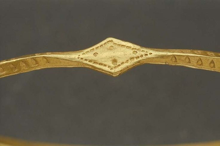 Viking gold arm ring. Found at Hässleberga, Sweden. The Swedish History Museum. (Another view)