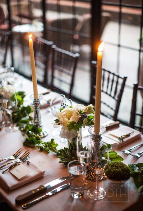 For a casual wedding, use simple green stems with low white floral centerpieces