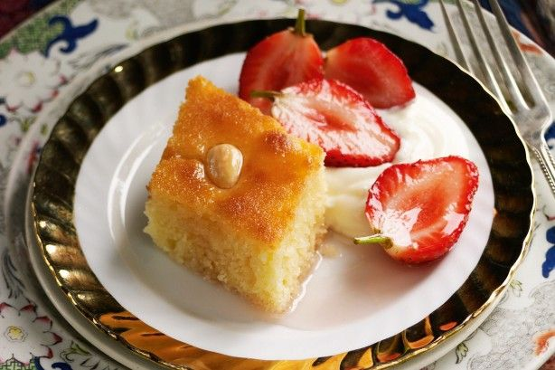 This traditional Middle Eastern semolina cake is perfectly paired with sweet strawberries in rose syrup.