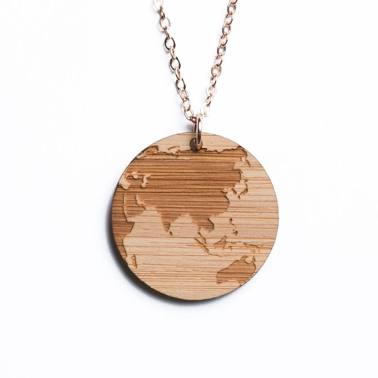 Asia, Australia, and Oceania map necklace, etched into eco-friendly FSC certified bamboo (using a laser burner), on a recycled rose gold plated sterling silver chain.