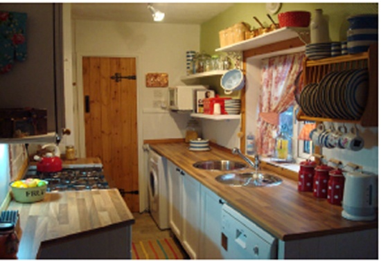 Cottage galley kitchen.  Pretty and bright!