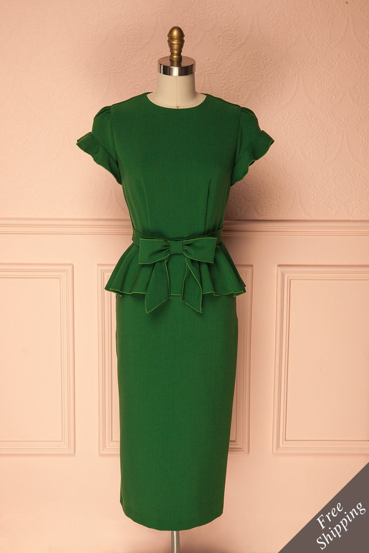 Cherin Emerald #boutique1861 / Let your femme fatale flag fly! This beautiful retro cocktail dress is well-fitted to show off your curves, while the long skirt length and round neckline give a mature and mysterious quality. For a little flounce and fun, there's the ruffle cap sleeves, draped peplum, and belt with a bow. Just add red lips, victory rolls, and a slingback heel to complete the look!
