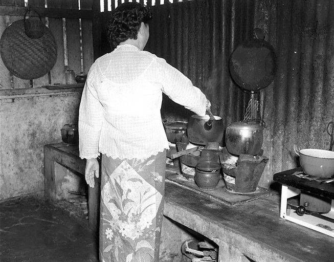 A Nonya Kitchen in the old days..with sarong encim