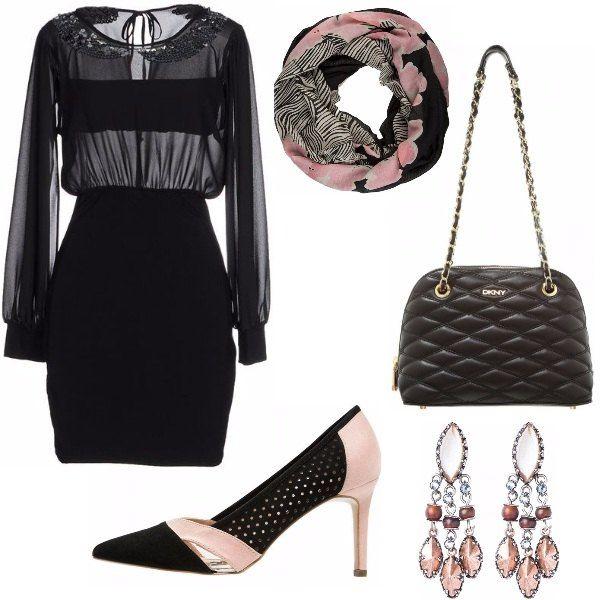 Il vestito nero con trasparenza non passa certo inosservato ma viene addolcito dalla nota rosa delle scarpe, del foulard e degli orecchini. La borsa trapuntata è comoda e portabile in molte occasioni.