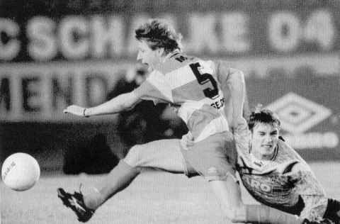 Robert Kovac vs. Frank Mill.  Robert Kovac of FC Nuernberg tries to stop Frank Mill of Fortuna Duesseldorf during a DFB Pokal quarterfinal match played on November 7th, 1995, and won by Duesseldorf, 1:0. It looks like Mill won this on the field encounter, and rather easily at that.