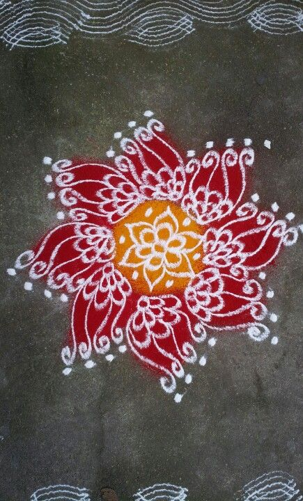 Rangoli- maybe have rangoli designs at the altar or on the runner or as table decorations