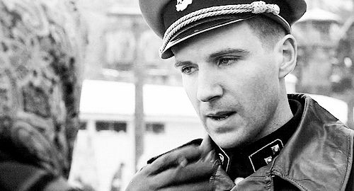 """Camp Commandant Amon Goeth, infamous from the movie """"Schindler's List"""", on the balcony of his house overlooking Plaszow labor camp, Poland. Description from pinterest.com. I searched for this on bing.com/images"""