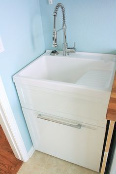 sweet laundry sink and ideas for using an Ikea wood countertop with a cutout for waterline access for the laundry area