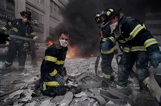 James Nachtwey / VII for TIME  On the Scene  Firemen struggle to extinguish blazes near the disaster site.