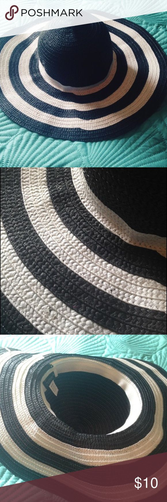 Stripe wide brim floppy beach hat Stripe beach style floppy hat. One size fits all. Worn maybe twice. In great condition. I just never got around to wearing it much. It's great for keeping the sun out of your eyes and face at the beach or gardening. Accessories Hats