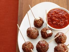 Giada's Meatballs a la Pizzaiola : There's a surprise baked inside each of Giada's bite-size meatballs featured in Food Network Magazine: a hunk of gooey mozzarella cheese that gently oozes out when you bite into it.