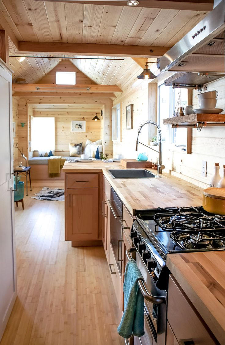 The kitchen is equipped with full size range, dishwasher, refrigerator, modern single bowl sink, and large pantry area.
