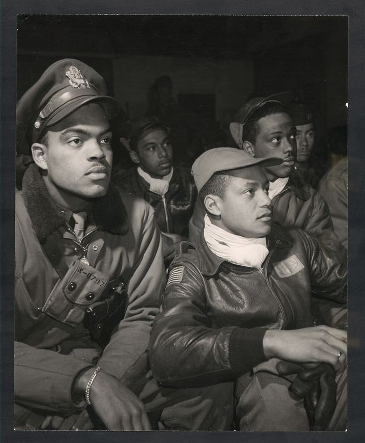 Tuskegee Airmen at a briefing in Italy in 1945. The squad of all African American pilots was formed in 1941 after extensive lobbying for funding by the press and civil rights organizations.  Prior to 1941 African American men were barred from flying for the U.S. military. The pressure resulted in the formation of an all African-American pursuit squadron based in Tuskegee, Alabama, in 1941.