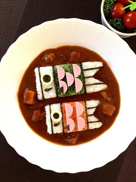 "May 5th is Children's Day. Japan cerebrates the day by putting up carp streamers.  One mother cooked ""curry and rice"" using the image of carp streamers.  What a warm and cute dish!   Cooked by Hiromi Hirabayashi.  photo by Hiromi Hirabayashi"