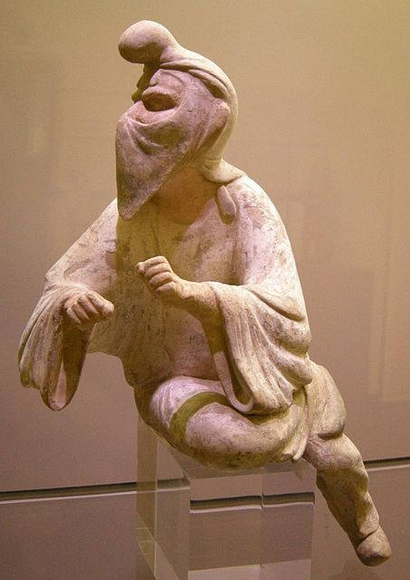 An 8th-century Tang dynasty Chinese clay figurine of a Sogdian man (an Eastern Iranian person) wearing a distinctive cap and face veil, possibly a camel rider or even a Zoroastrian priest engaging in a ritual at a fire temple, since face veils were used to avoid contaminating the holy fire with breath or saliva; Museum of Oriental Art (Turin), Italy.[61]