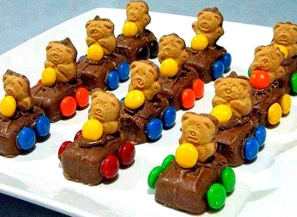 VERY CUTE PARTY IDEA!!! Mars Bar Cars I made these for the kids and they loved them. No Mars Bars try Snickers or Milky Way Minis. Thanks Misty for the suggestion !!! Please note there is no recipe for this picture: It is a collection of food that is already made: Teddy cookies, M's or skittles, chocolate frosting and min chocolate candy. Use the frosting for attaching the items together.