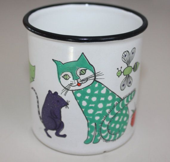 Lovely Nooan Arkki  Noahs Ark  childrens enamel mug by Finel Finland.  Adorable enamel mug featuring a kissa cat, hiiri mouse, orava squirrel, and a ampiainen bee. Noahs Ark was designed by Gunvor Olin-Grönqvist for Finel.  This highly sought after mug measures just over 3 in height, 3 in diameter, and is 4 1/4 from handle to the rim. Mug is in very good vintage condition with wonderfully bright colors. please note that the mug has one small spot of loss of enamel inside of the mug, and ...