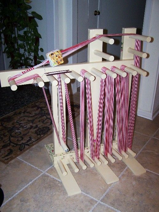 Free plans for a standing inkle loom from Linda Shuster - there are 14 yards of trim on there!