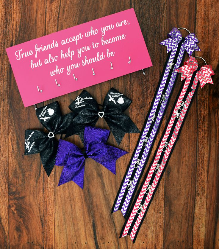 Custom set comprising medal holder, 2 bow holders and 3 bows.