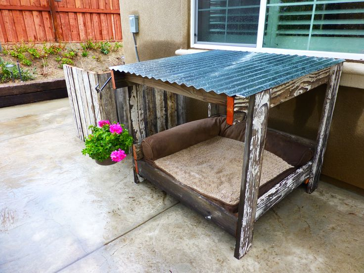 Dog house, old fence wood and a pallet = dog house,a/c cover,and both planters!