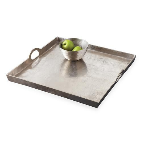 This square silver serving tray is smartly fashioned with 3-inch walls on every side, allowing you to feel secure when carrying cocktails or finger foods into your Hollywood regency dining room.  Twirl around, nothing will fall!  A truly glamorous addition to your serve ware.