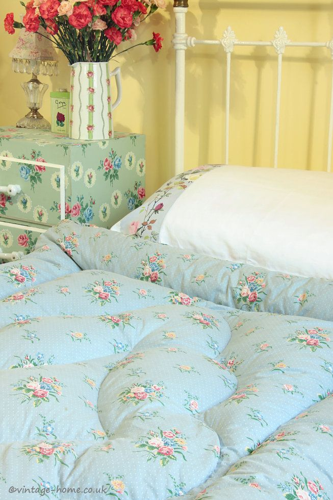 A pretty vintage eiderdown on the guest bed at Pottery Cottage: www.vintage-home.co.uk