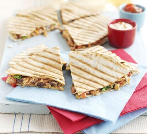 tnt - Refried bean quesadillas -these were delicious! Did add left-over cooked chicken and served with avo and lettuce. Much more successful heated under the grill than on a pan. Yum. Make again!