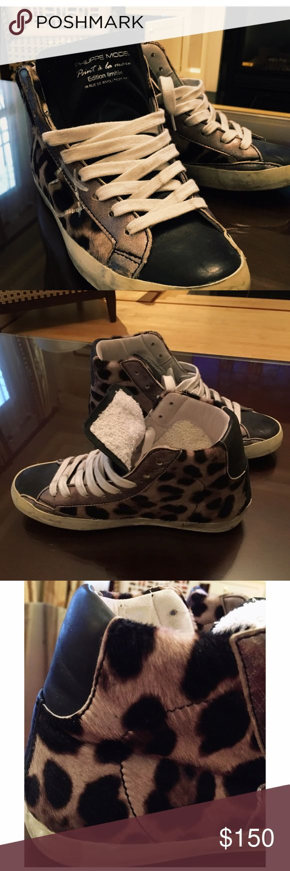 Philippe Model sneakers with wedge heel Philippe Model, leopard print sneakers with wedges heel. Worn only once, they are meant to look slightly distressed. Philippe Model Shoes Sneakers