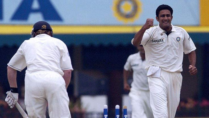 Anil Kumble (R) celebrates the dismissal of England's Paul Collingwood during a Test match in India