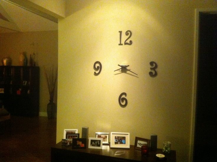 homemade wall clock made of crafted numbers and a recycled