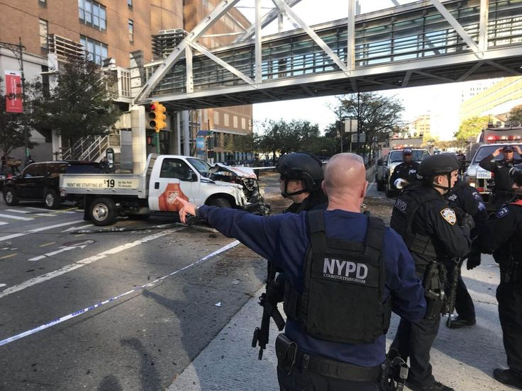 A number of people were shot near Stuyvesant High School Tuesday afternoon, police said, and one person was taken into custody.    Police were investigating reports of up to four people shot dead.    Witness Frank Brito, 45, told the Daily News he saw two trucks crash into each other and then a heavy set man get out of one in a blue tracksuit and chase someone, firing five or six times.