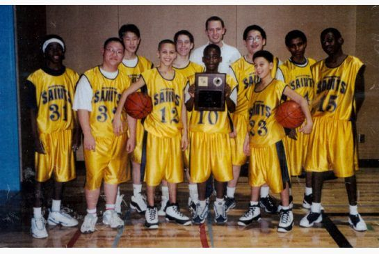 Stephen Curry, third from left in front row, with the Queensway Christian College Saints basketball team.
