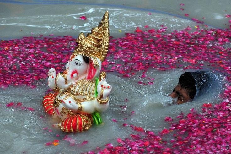 SUBMERGED: A Hindu devotee carried an idol of the Hindu god Ganesha on the fifth day of the festival Ganesh Chaturthi, in Mumbai on Friday. ...