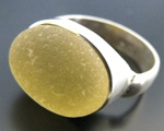 A rare, golden oval sea glass piece is hand set into a sterling silver ring.Adornment Seaglass, Sea Glass