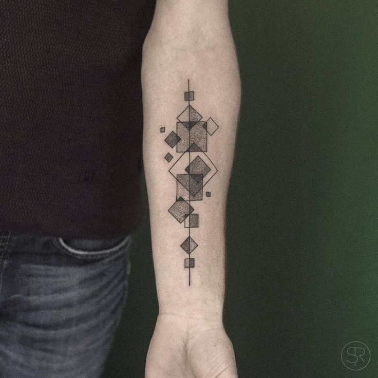 Intersecting squares tattoo on the left inner forearm.