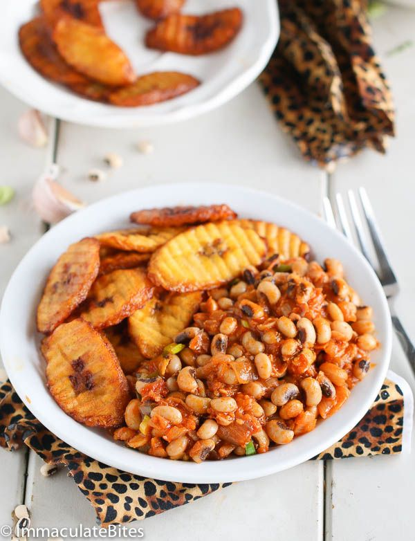 Ghanaian Red Red /      4 -14.5 ounce canned beans or 1 pound dried beans.     ½ – ¾ cup palm oil or Canola oil.     1 medium Onions.     1 Tablespoon ginger.     ½ tablespoon garlic.     2 Tomatoes.     2 Tablespoons tomato paste.     1 Tablespoon paprika.     • ⅓ crayfish (optional)     • 2 cups – 3 cups stock/ water.     • 1-tablespoon bouillon powder, vegetarian, chicken (optional).     2-3 green onions chopped.     Salt and pepper as needed.     1 habanero pepper or sub with hot pepper…