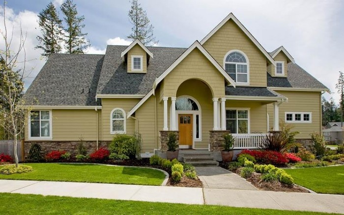 yellow house with beautiful landscaping | cute houses ...