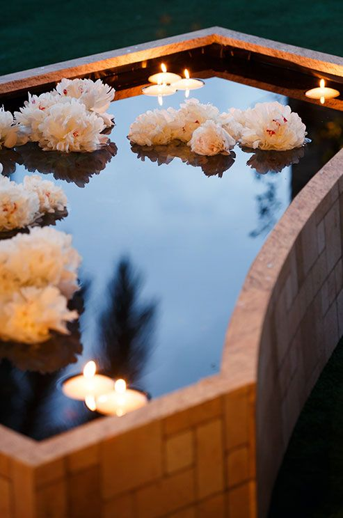 25 best ideas about floating candle bowls on pinterest floating flower centerpieces fish for Floating candles swimming pool wedding
