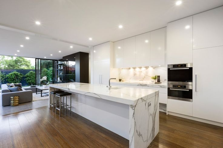 White no hardware high gloss, cabinets + thick white marble island and countertop