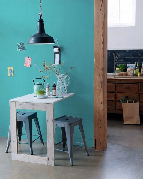 A really great example of the two legged table in a small space. (Also love the wall color).